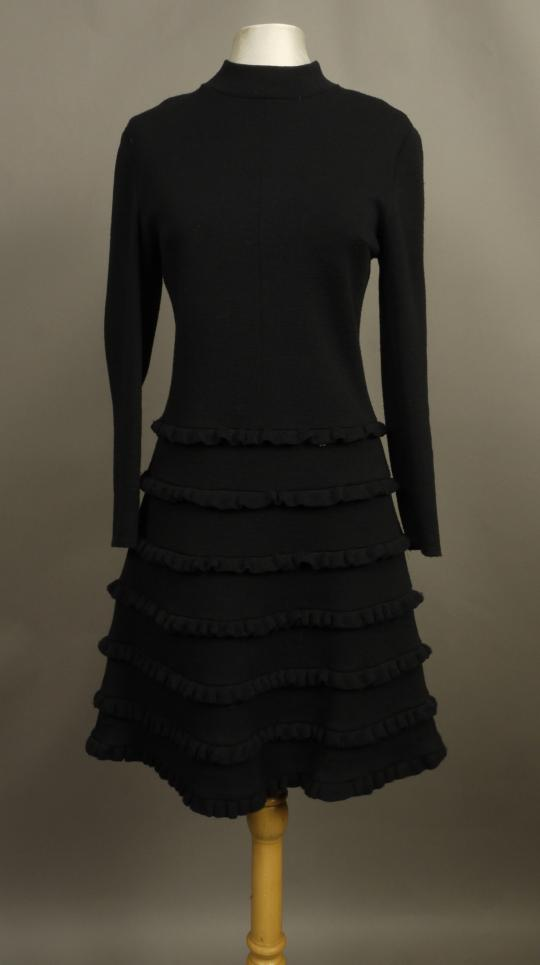 f57da6700 A early 70s Frank Usher black jersey cocktail dress with stand up collar,  full sleeves the A line skirt tiered with bands of ruffled trims